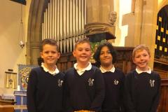 Youngsters present harvest donations to local food bank