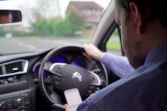 Clampdown on people using mobile phones at the wheel