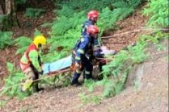 Fire crew rescue man from embankment in Alderley Edge