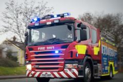 Firefighters extinguish grass fire in country park