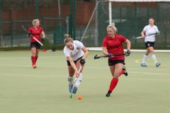 Hockey: Edge weather the wind to win