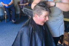 Club President braves the shave for charity